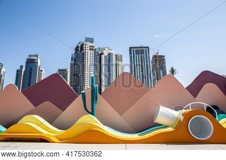 Dubai, Uae, 22.02.2021. Modern Art Installations With Sand Dunes And Cactus On Dubai Creek Marina Pr