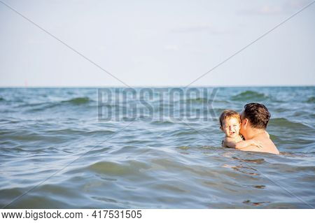 Fatherly Love Concept. Best Dad. Father Bathes A Little Cute Toddler Daughter In The Water Of A Warm