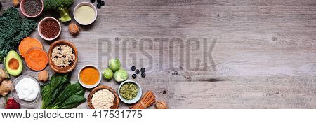 Healthy Food Ingredients. Above View Corner Border On A Wood Banner Background. Copy Space. Super Fo