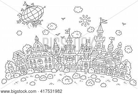 Airship Flying Over Pretty Houses, Castles, Palaces And Towers Of An Old Small Town From A Fairytale