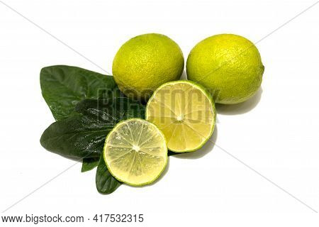 Fresh Lime Fruit. Whole Fruits And Cut. Lime Leaves. Studio White Background.