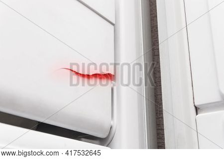 Crack On The Polystyrene Lid Of The Refrigerator Freezer, Close-up. The Need To Repair The Refrigera