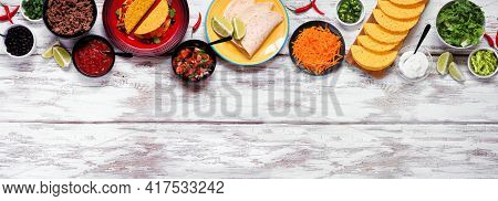 Taco Bar Top Border With An Assortment Of Ingredients. Overhead View On A Rustic White Wood Banner B