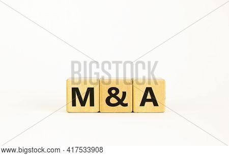 Mergers And Acquisitions Symbol. Concept Words 'm And A - Mergers And Acquisitions' On Wooden Cubes