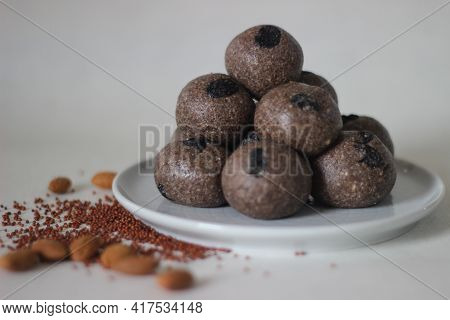 Ball Shaped Indian Sweet Made With A Mixture Of Finger Millet Flour, Sugar, And Shortening. Locally