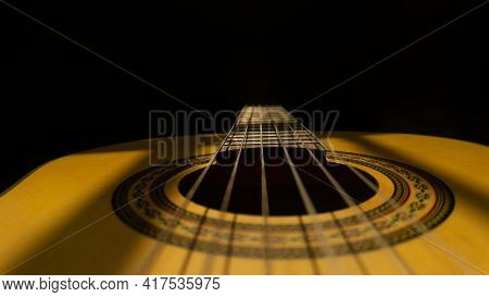 Nice Shot Of The Guitar Strings With Blackbackground