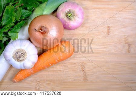 Close Up Of Various Vegetables On A Wooden Background