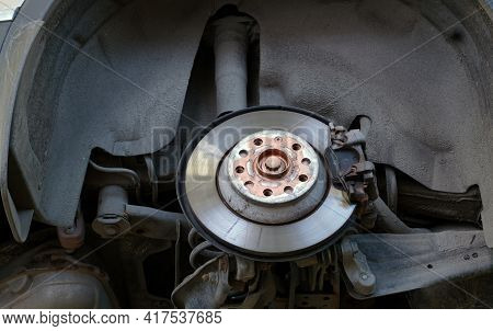 A Car In A Car Service On A Lift With A Wheel Removed. Brake Disc, Brake Caliper. Car Service And Sp