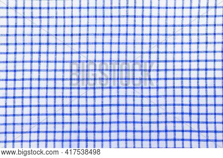 Kitchen Cotton Tablecloth Or Napkin With A Pattern Of Blue Squares On A White Background.