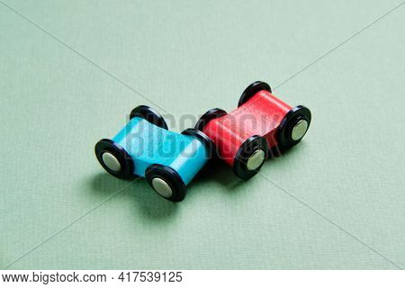 Blue And Red Toy Cars Crash. Car Crash Insurance.
