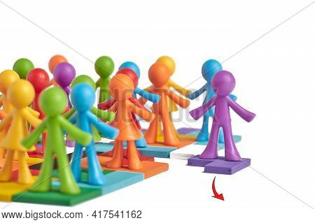 . A Group Of Human Figures Standing On Puzzles Moves In One And The Same Direction, One Person Went