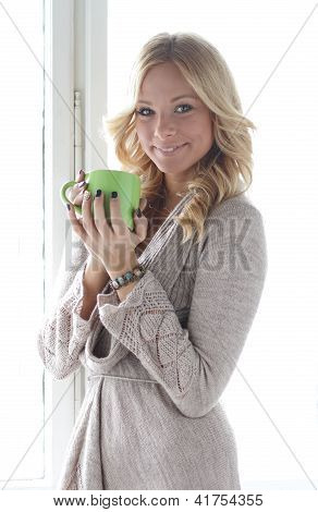 Blonde girl with a cup of tea