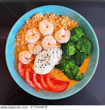 A Bowl Of Instant Noodle With Vegetables And Shrimps