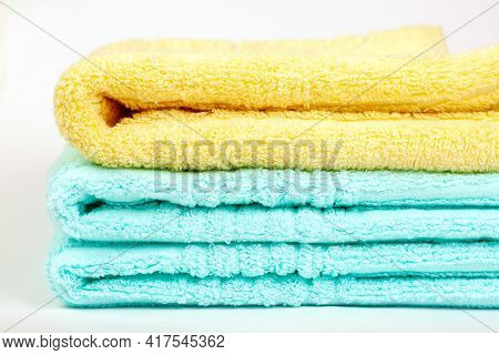 A Stack Of Terry Towels Folded In A Stack