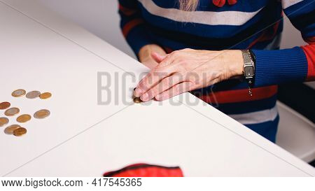 Close Up On Wrinkled Hands Of An Elderly Woman Counting Money. High Quality Photo