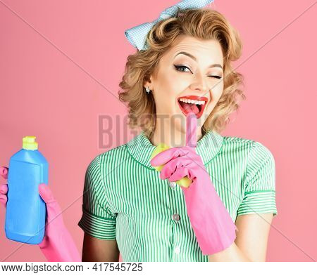 Funny Housewife With Cleaning Sprayer. Housewife, Isolated. Woman Housekeeper In Uniform With Clean