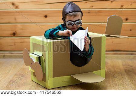 Baby Play In Cardboard Plane, Childhood. Pilot Travel, Airdrome, Imagination. Kid, Pilot School, Inn