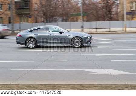 Moscow, Russia - March 2021: Side View Of Gray Mercedes-amg Gt 4-door Coupe. Fast Moving Car On The
