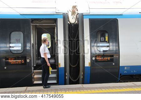 Lodz - Poland. 18 June 2019:  Train Conductor During Stop At The Station. Modern Carriages Of Passen