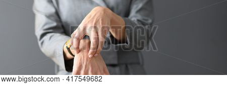 Woman In Gray Dress Scratching Her Hands Close-up