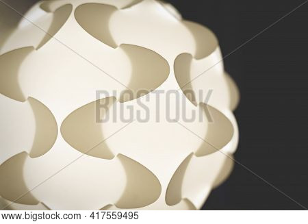 Detail Of A White Illuminated Puzzle Lamp From The Sixties With Geometric Shapes