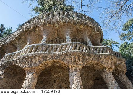 BARCELONA, SPAIN - MARCH 22: Park Guell by Antonio Gaudi. Stone colonnade resembling tree trunks by Antonio Gaudi in Park Guell, Barcelona. Spain
