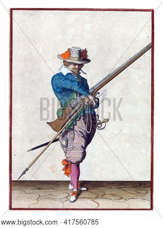 A soldier, full-length, to the right, holding a musket (a type of firearm) with his left hand. In his left hand, in addition to the musket, also a furket (musket fork) and a burning fuse