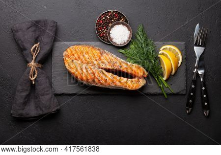 Grilled salmon steak. Fish steak with herbs and spices. Top view flat lay