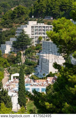 Makarska, Croatia - September 5, 2019: Big hotel complex at Adriatic sea in Makarska riviera at sunny day in Croatia