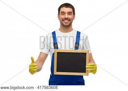 profession, cleaning service and people concept - happy smiling male worker or cleaner showing chalkboard and thumbs up over white background