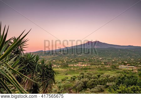 Majestic Etna volcano landscape at dawn in Sicily, Italy. Rural sicilian landscape with mount Etna in the morning