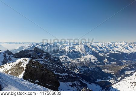 Mountain Landscape, The Seven Churfirsten In Snowy Winter, Photographed From The Säntis, By Day, In