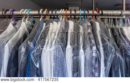 freshly washed shirts in a dry cleaner