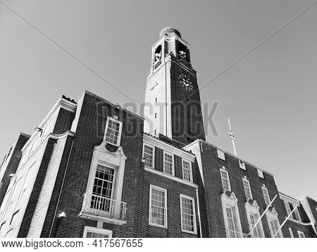 LONDON, UK - 18th April 2021: Barking town hall and clock tower in London's East end, built in 1958, taken in black and white