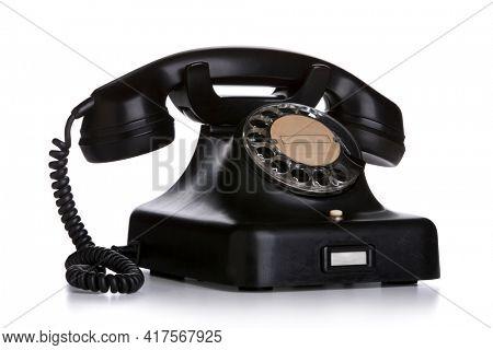 Vintage black telephone isolated on white background
