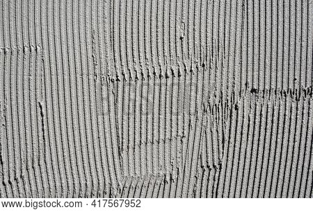 tile adhesive was applied to a wall