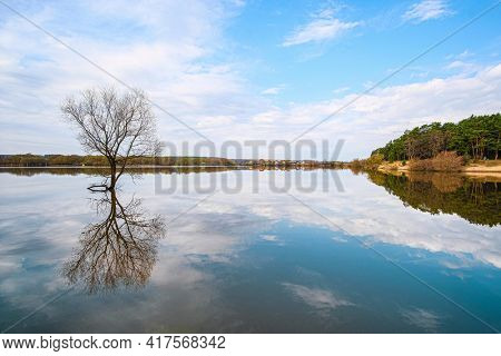 Spring landscape with the image of high water