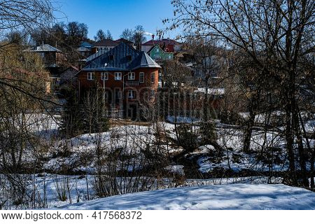 Country winter landscape with the image of village
