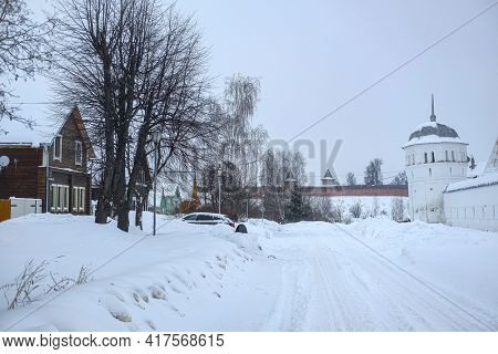 Winter landscape with the image of  old russian town Suzdal