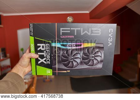 Budapest, Hungary - Circa 2021: Nvidia Geforce RTX 3090 Graphics Card manufacturer EVGA held in hand. High end GPU, sought after piece of hardware in low supply in the end of 2020