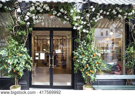 New York City - April 18 2021: Plants, Flowers, And Oranges Growing Over An Entrance Of Store. Vinta