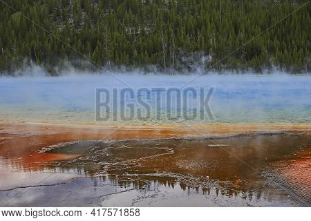 Prismatic Pool With Colored Earth And Hot Water In Yellowstone Park