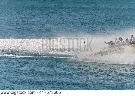 Airlie Beach, Queensland, Australia - April 2021: Water Spray Engulfs A Jet Boat As It Spins As Part