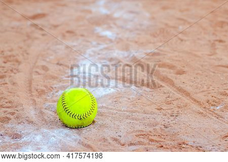 Old Softball In A Softball Field In California Mountains On A White Line