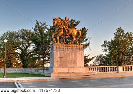 Washington, Dc - Apr 4, 2021: Arts Of War, Bronze, Fire-gilded Statue Groups On Lincoln Memorial Cir
