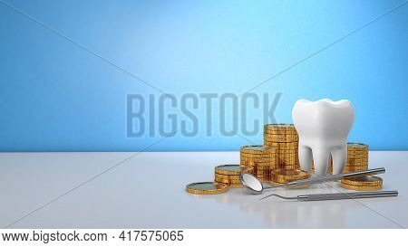 Gold Coins Money And A Tooth With A Dental Mirror. Expensive Dental Treatment. Dental Insurance. Blu