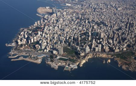 """Aerial image of Beirut Lebanon showing """"Ras Beirut district"""" the Corniche and the famous Pigeon Rocks amongst other landmarks poster"""
