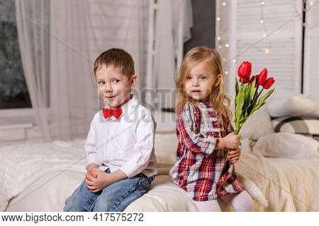 Cute Stylish Children. True Love. Happy Children In Casual Clothes. Portrait Of Smiling Boy And Cute