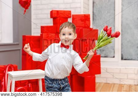 Funny Kid Congratulate Mother On Holiday And Give Flowers. Cute Child Congratulating Mother Happy Mo