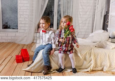 Little Girl And Boy Enjoy Life. Attractive Young Kids. Forever Friends. Happy Children In Casual Clo